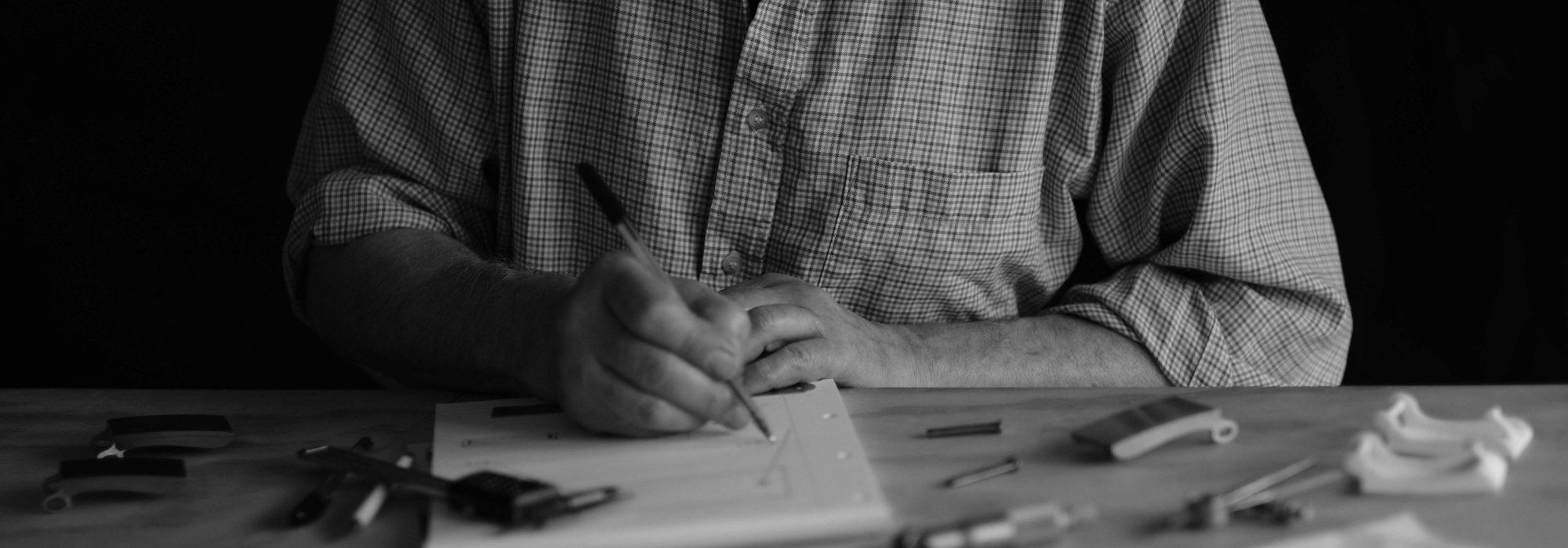 Mr Tallett working on design
