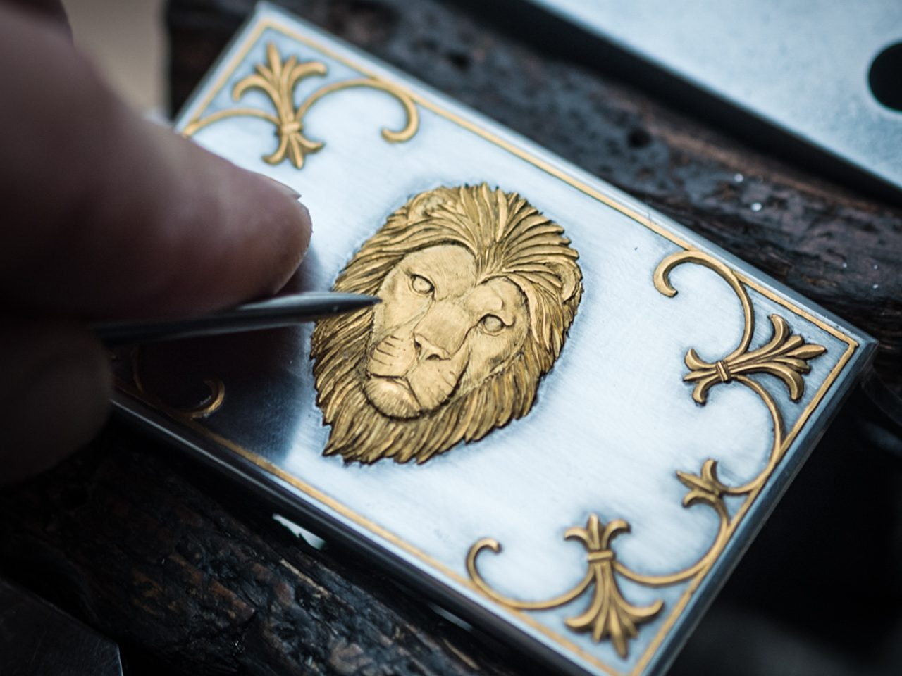 Ferrum and Hide 24ct gold lion carved_